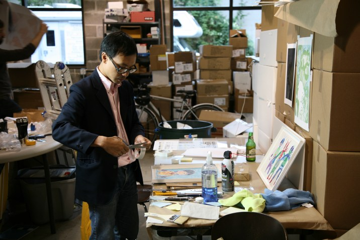 Tae Style: hand-making frames in a sports coat.