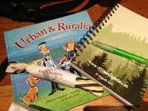 Urban och Ruralia är en barnbok för förskolan som handlar om staden och landets ömsesidiga beroende.