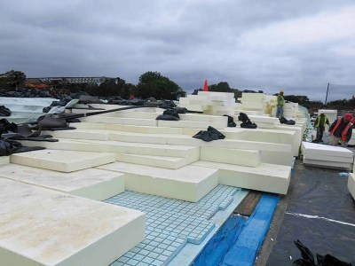 Lightweight blocks of geofoam expanded polystyrene form a base layer for the roof. Courtesy: Ken Smith Workshop.