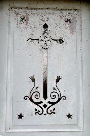 cross on metal door