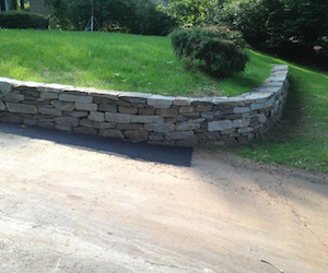 Curved granite retaining wall