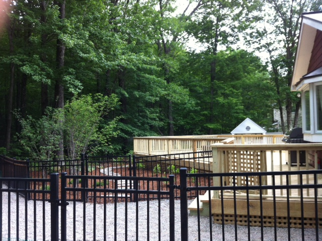 New larger deck and landscaping provides better solution for family activities, entertainment of guests, and dog yard play space.