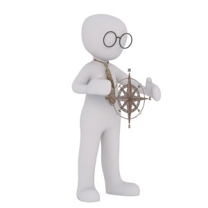 Image for LEJOG What to take - Man holding Compass