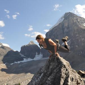Stretching exercises for cyclists - yoga on a mountain top image