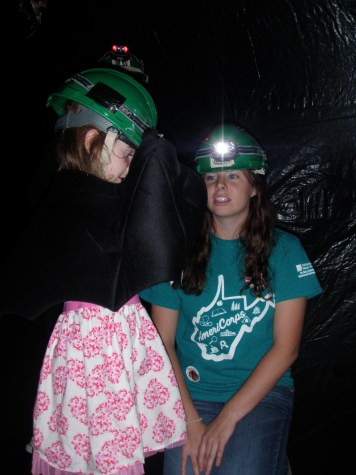 AFHA AmeriCorps member answering bat questions inside the bat cave.