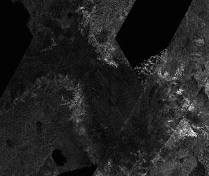 Mosaik pmetaan permukaan Titan. Kredit : NASA/JPL