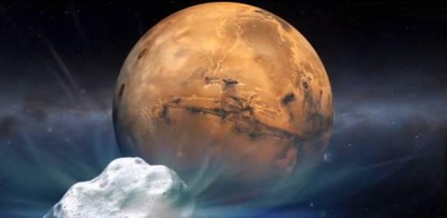 Gambar 2. Gambaran artis saat inti komet Siding-Spring (latar depan) berada pada titik terdekatnya dengan planet Mars. Inilah peristiwa langit yang langka dan belum tentu bakal terulang kembali dalam berpuluh atau malah bahkan hingga beratus tahun lagi. Sumber: NASA, 2014.