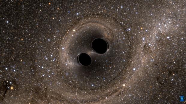 Gambar ini mengilustrasikan dua lubang hitam yang saling mengitari satu sama lain. Sistem semacam inilah yang menciptakan gelombang gravitasi yang berhasil dideteksi untuk pertama kalinya. Kredit: MIT-Caltech.
