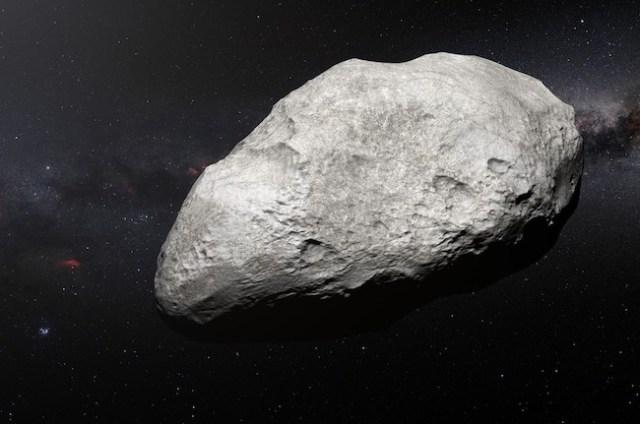 Ilustrasi asteroid 2004 EW95 yang berkelimpahan karbon di Sabuk Kuiper. Kredit: ESO/M. Kornmesser