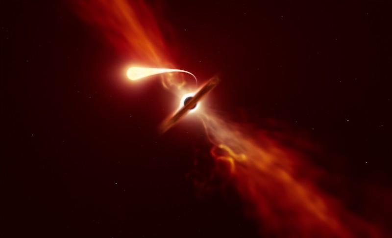 Ilustrasi peristiwa bintang yang mengalami spagetifikasi dan melontarkan materi. Kredit: ESO/M. Kornmesser