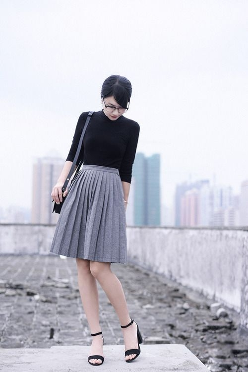 pleated grey wool skirt with black sweater neutral work