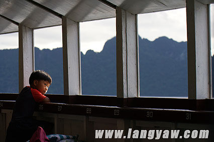 A boy looks out into the magnificent view early in the morning