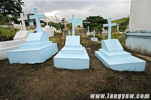 Newly painted graves at the cemetery