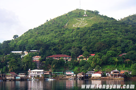 The town of Culion with its spread eagle emblem carved on a hill face