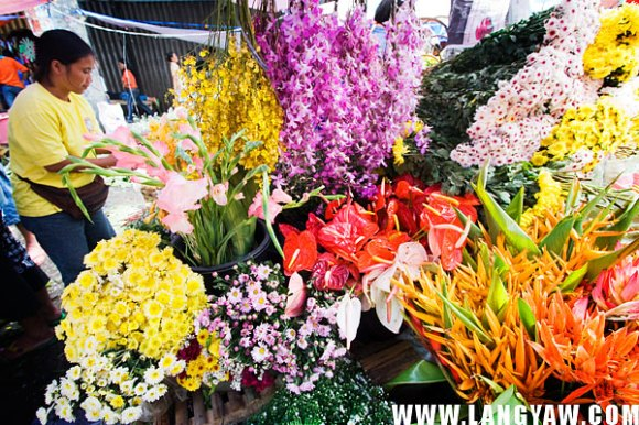 A street near Carbon market is closed to traffic for flower vendors to spread their wares.