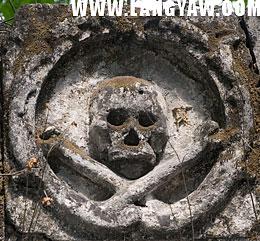 Skull and crossbones medallion at facade of Calamba cemetery