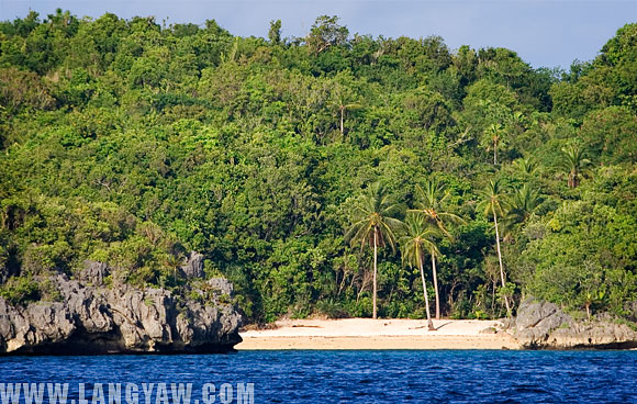 A secluded white sand beach in one of the islets that dot the sea.
