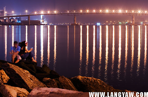 The rocks at the base of Fernan Bridge offers locals perfect seats to enjoy the citylights.