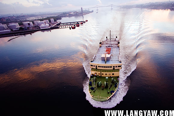 A rare view from the top offers spectacular scenes like this passenger ferry as it passes under the old bridge.