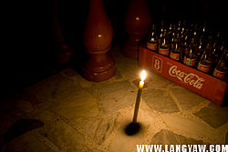 A candle is lighted near the door of houses in Talisay City.
