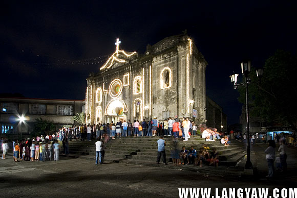 The historic Guadalupe Church in Makati is packed full with people spilling outside for the traditional Simbang Gabi