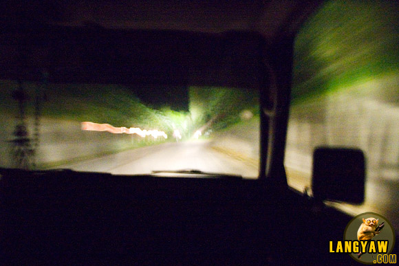 4 AM trip from Caticlan to Kalibo by van. Feels eerie traveling on a long and deserted dark road without streetlights.