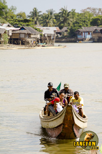 People from the surrounding villages around the river board these motorized pumpboats to cross to the other side.