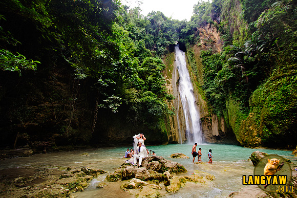 Newlyweds on a photoshoot in Mantayupan Falls, Barili