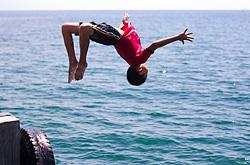 A lad having a good time at Olutanga's wharf