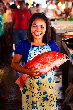A fishmonger at the public market