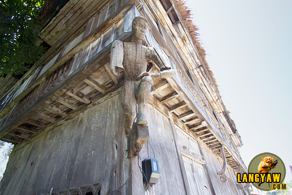 Sculpted effigies of men bear the second floor of t he Vega ancestral house on there shoulders. Balingasag, Misamis Oriental