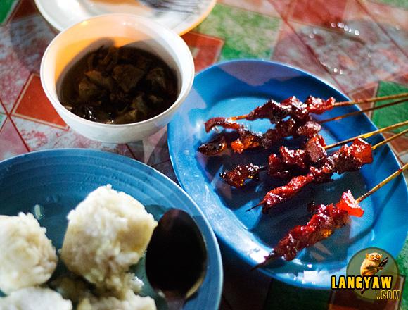 Puso rice, pork barbecue and halang halang