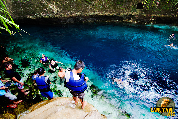 Enchanted River deluged by people