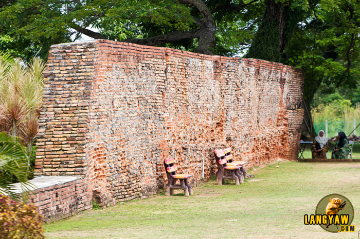 Fort walls make as a backdrop for park benches