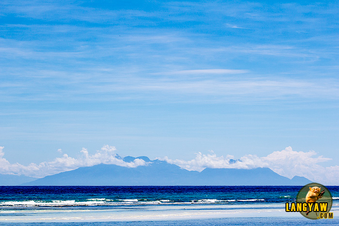 From Quinale Beach in Anda, the silhouette of Camiguin can be seen