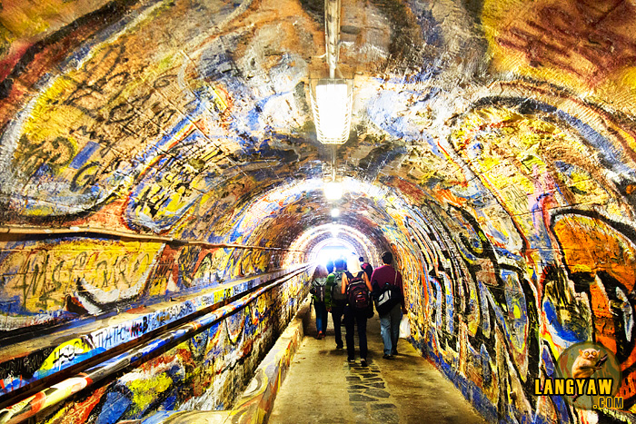 Colorful graffiti has taken over all the surface of the tunnel walls