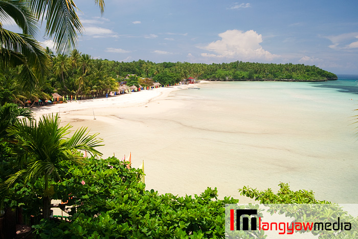 Beautiful Santiago White beach, a public beach in Santiago Bay, Camotes Island group as seen from an elevated point