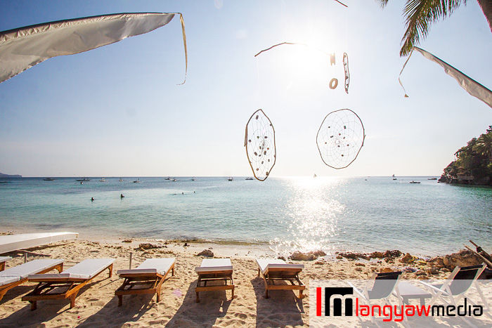 Beach lounging chairs and dream catchers