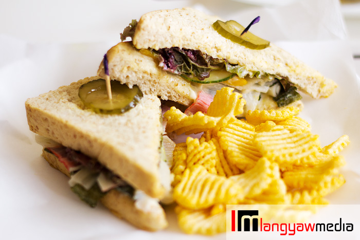 Crab salad in whole wheat flour sandwich with chips