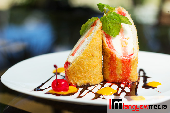 Vanilla melt tempura: this fried ice cream has  sliced mango and puree plus ice cream inside topped with mint leaves and drizzled with chocolate syrup and cherry