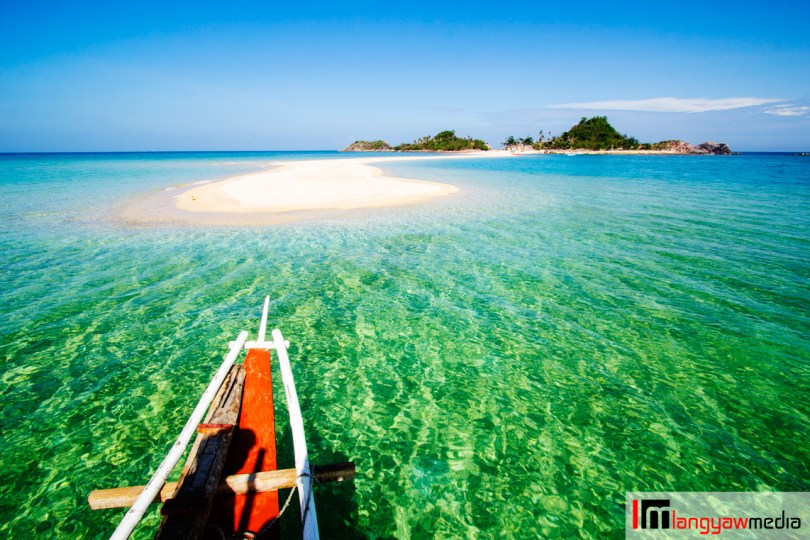 Emerald waters, red banca, glorious white sandbar!