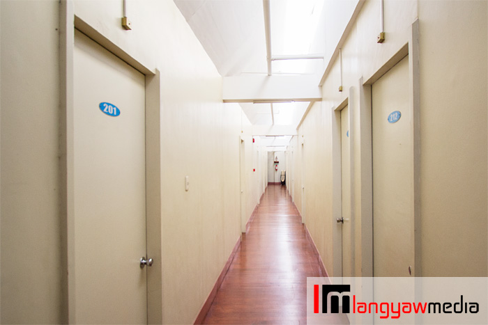Hallway of the private aircon rooms with en suite toilet and bath