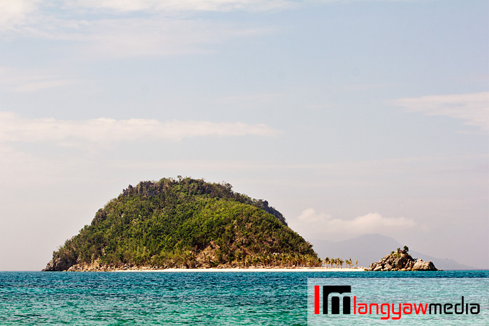 Cabugao Dako islet as seen from Bantigue Island and sandbar. Taken with a super telephoto lens.