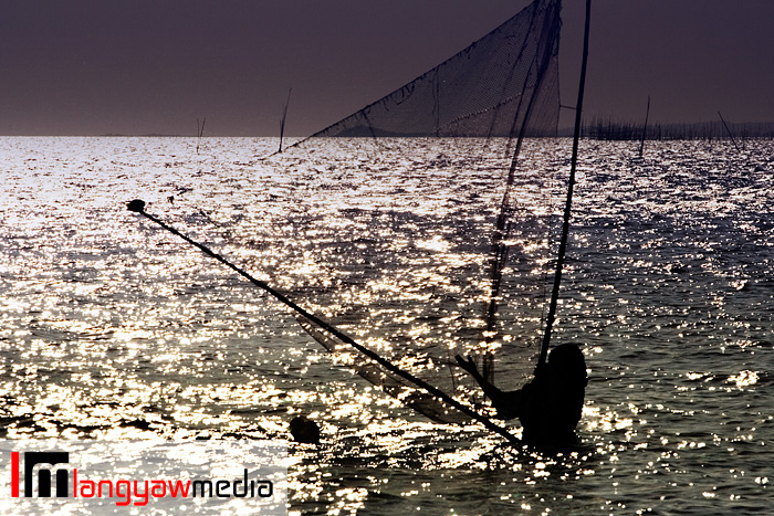 Shrimp trawling in the shallow coast of Valladolid in Negros occidental before the sun sets