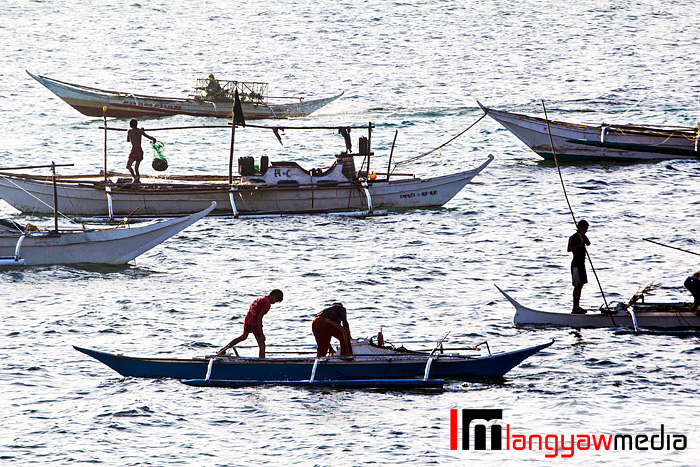 Fishing boats gathering near the shore early in the afternoon in Gigantes Norte, Carles, Iloilo