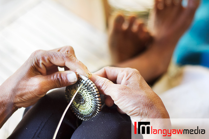 A Mangyan weaving a small basket's cover