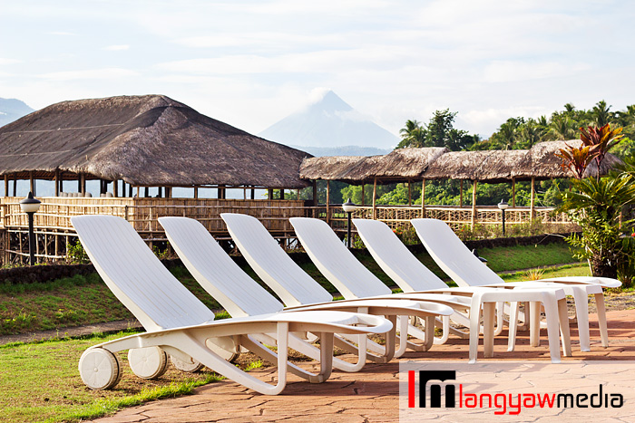Pool lounge chairs with Mt. Mayon in the background