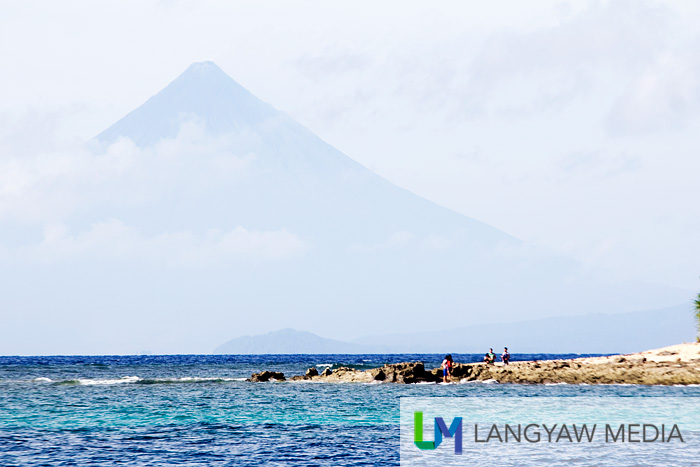 The northern rocky portion of Aguirangan Island with Mt. Mayon in the background