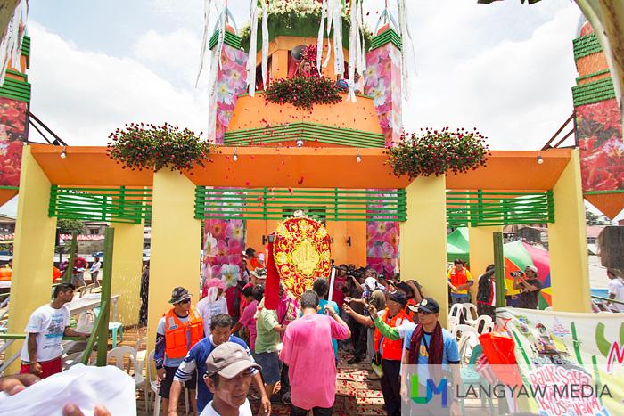 The Mahal na Poon ng Krus sa Wawa is brought inside the pagoda