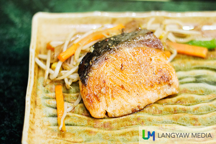 Fresh salmon with vegetables and ginger sauce